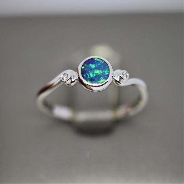 Elegant White Gold Round Opal Ring and Diamonds