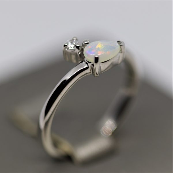 Australian Drop Solid Opal & CZ Crossed Ring -L
